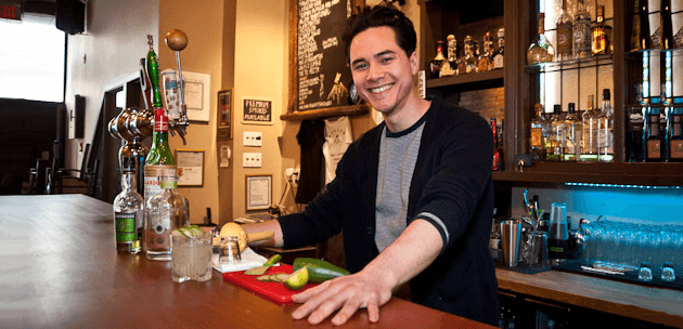 Friendly bartender using interpersonal customer service skills